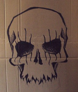 skull drawn in pen on coffin for alice cooper performance