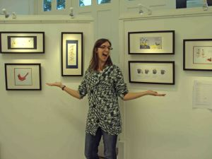 laura elliott with her illustrations at GradGallery exhibition