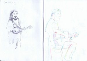 leon hunt n-tet - one of the band members in dungarees at gossington festival.  And man playing guitar during a jam session