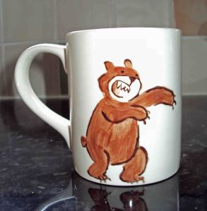 roaring bear painted by laura elliott on the side of a mug