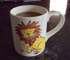 lion mug painted by laura elliott