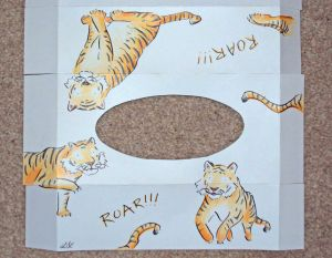 top of tissue box net with pen ink and pencil coloured tigers jumping and roaring
